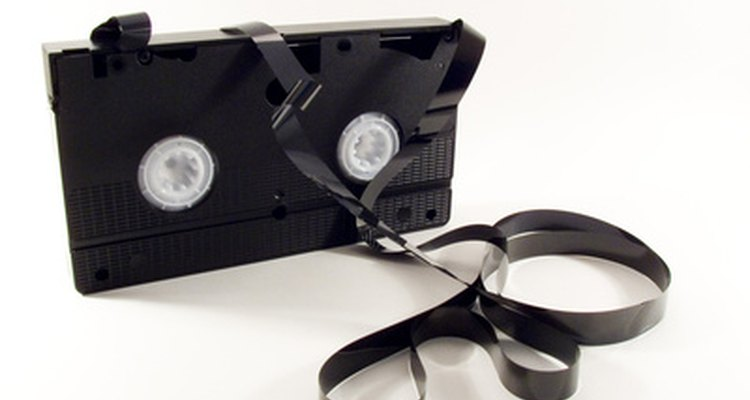 VHS cassette with exposed, snarled videotape.
