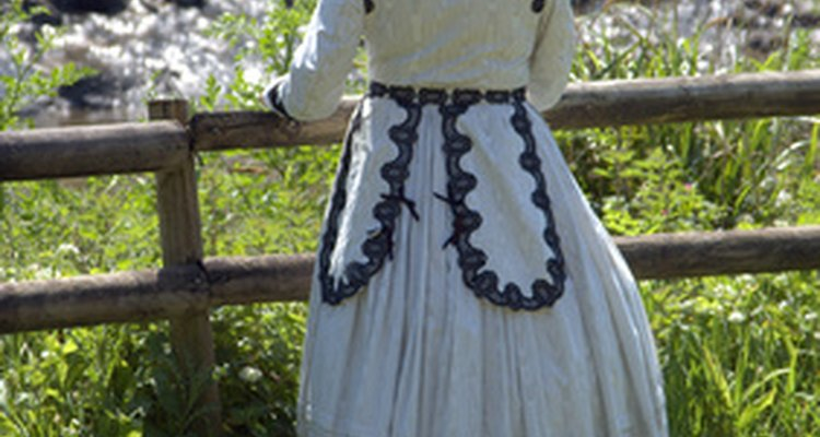 Victorian dresses are fitted at the top with wide domed skirts.