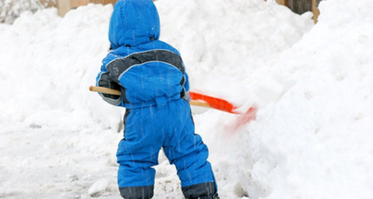 Shovelling snow is a way for youngsters to earn money.