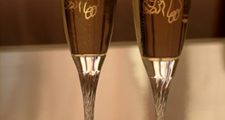 Decorate plastic champagne flutes by etching them.
