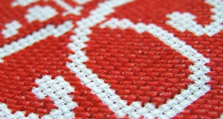 A close-up shot of cross-stitched Aida cloth.