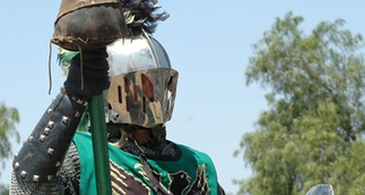 Your papier-mâché knight helmet will become hard once it dries.