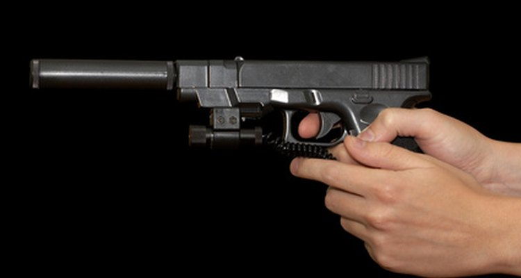 Glock handgun with a silencer.
