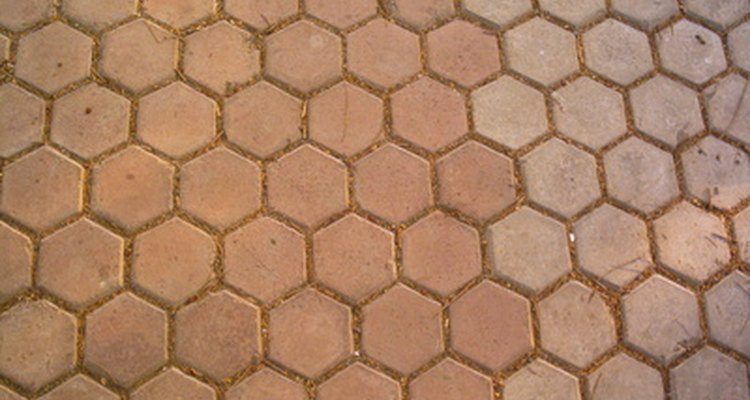 Remove hexagonal quarry tiles as you would any quarry tile.