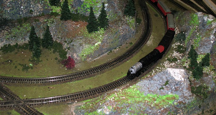 Make a cave where the toy train enters and comes out the other side.