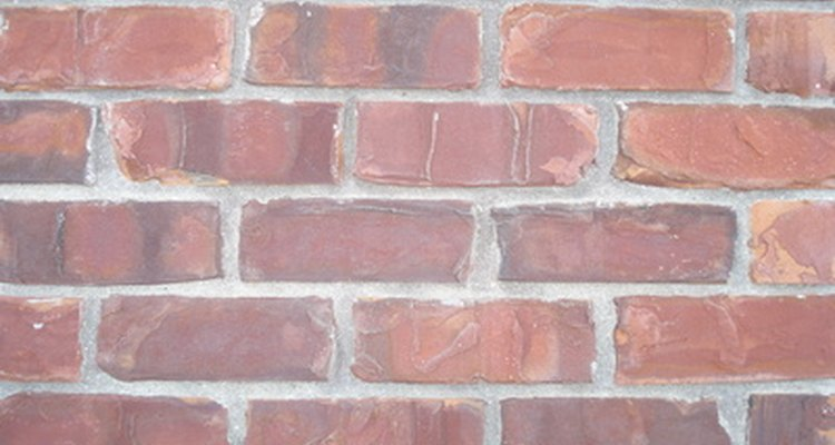 Remove rust from brick with a rust remover solution.