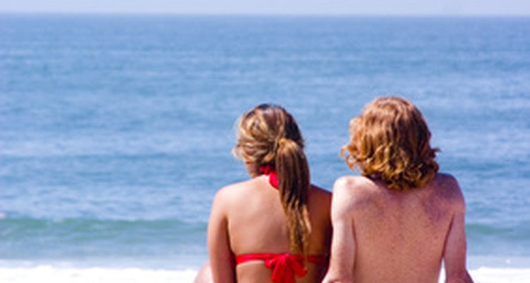 A romantic date idea for teens is visiting a white sandy beach,