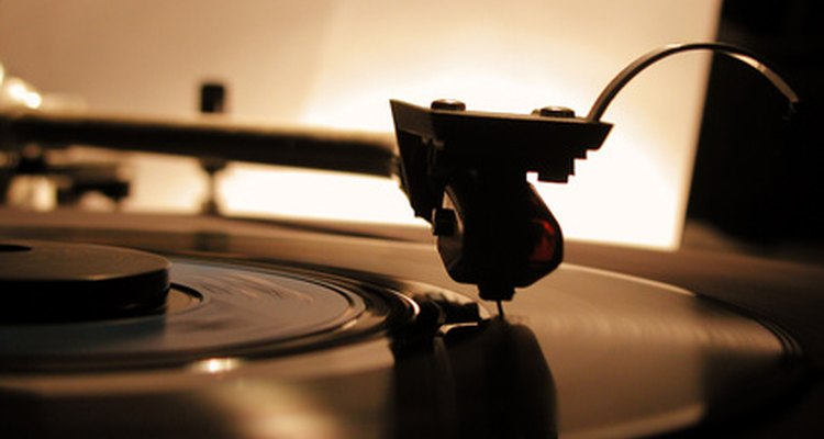 Removing adhesive from vinyl record labels.