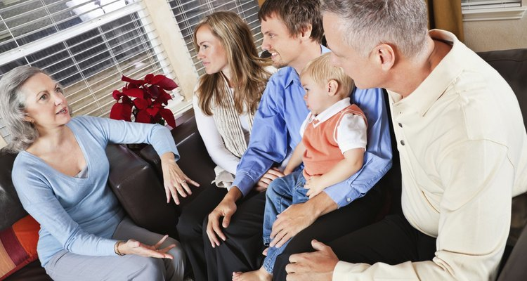 Grandparents Talking to Children's Family in Living Room