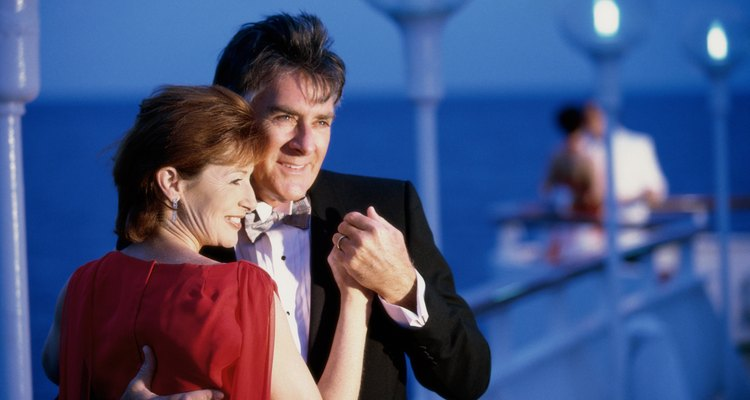 Close-up of a mature couple dancing on the deck of a cruise ship