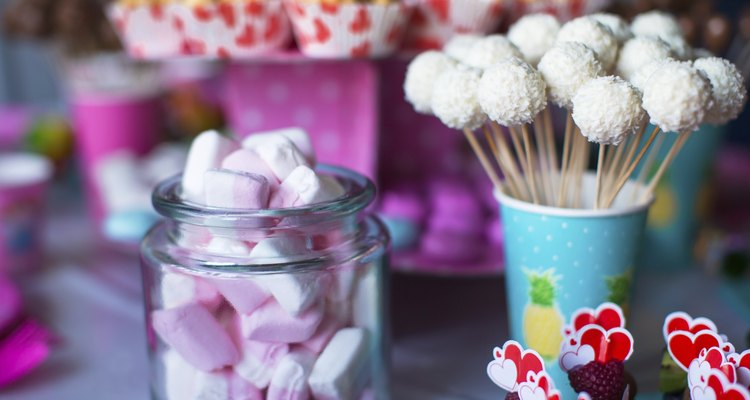 Marshmallow, sweet colored meringues, popcorn, custard cakes and cake pops