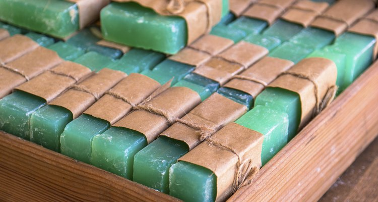 Green soap bars in a wooden box