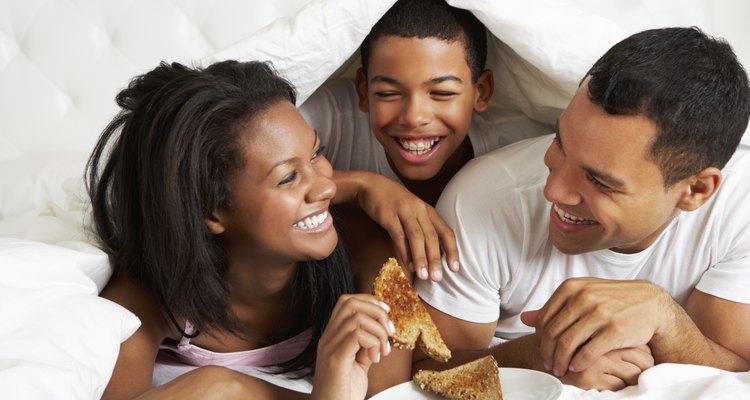 Family Enjoying Breakfast In Bed