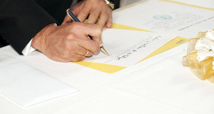 Man Signing a Rites of Matrimony Document