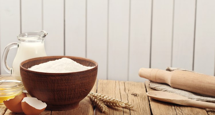 Flour in a bowl on a rustic wooden kitchen table