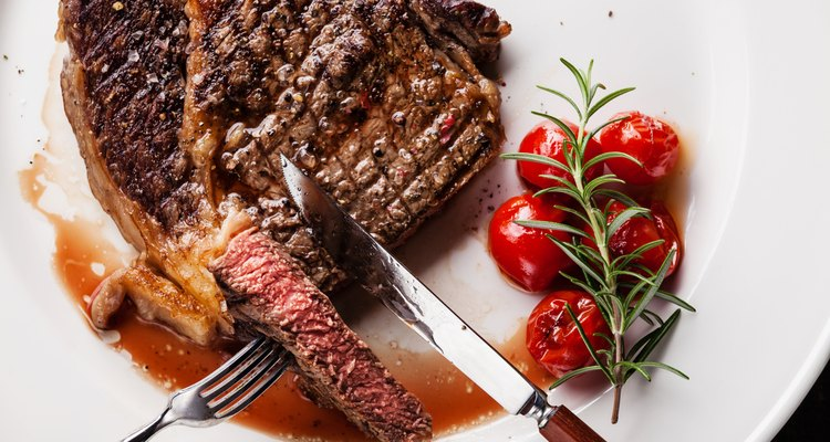Sliced grilled steak Ribeye with grilled cherry tomatoes