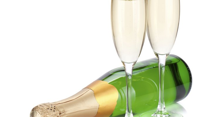 Lying champagne bottle and two glasses