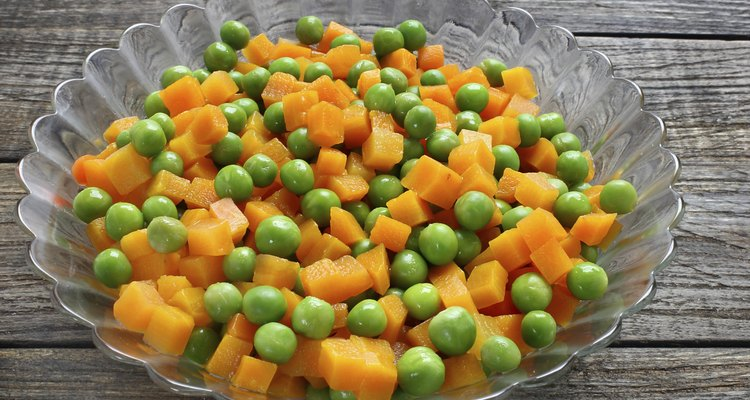 Boiled carrots with green peas