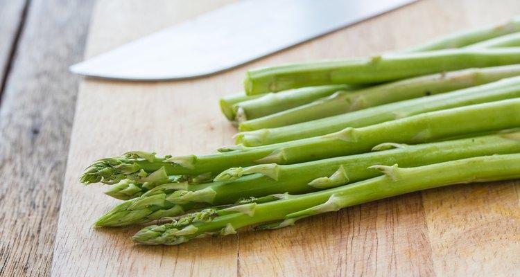 asparagus on wood background.