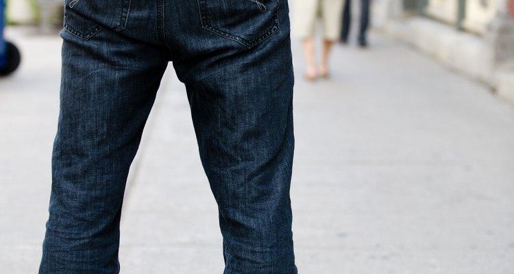 Man standing outdoors on sidewalk