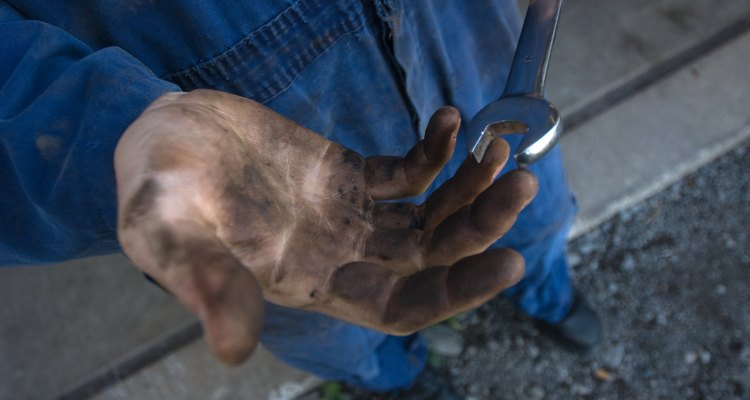 Hand tools and a willingness to get dirty are necessary to install a drop kit.