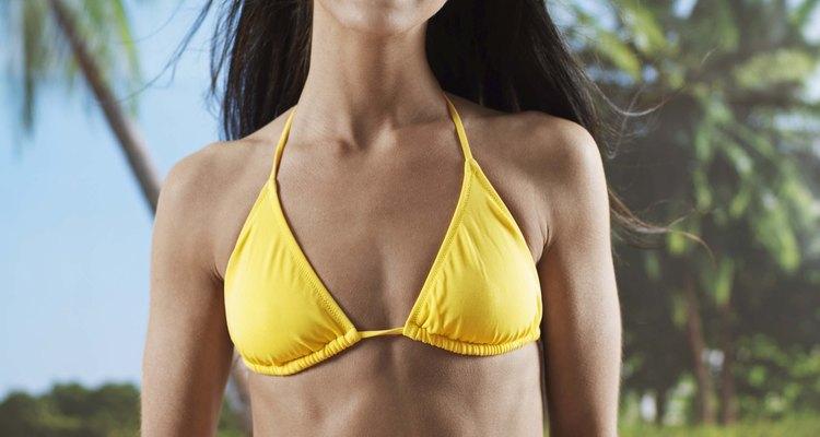 Barrigas definidas podem ser obtidas tanto por homens quanto por mulheres através de uma rotina disciplinada de exercícios