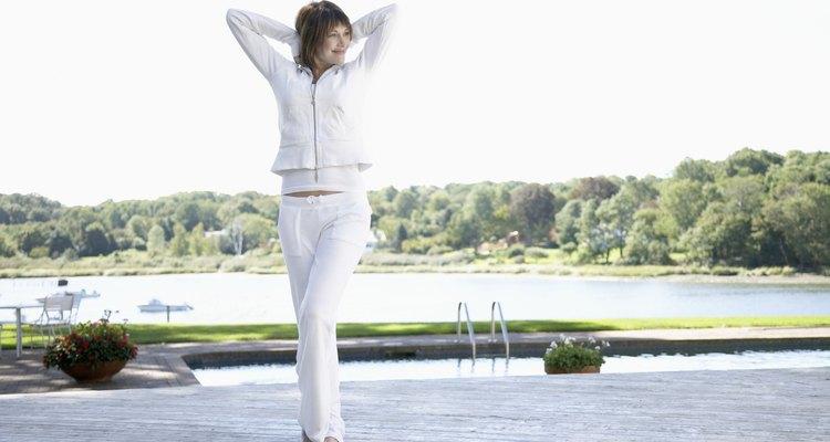 Woman stretching near pool
