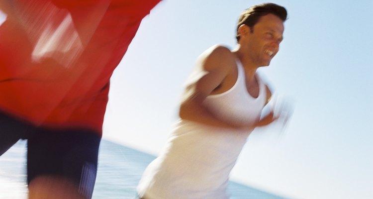 Men running on the beach