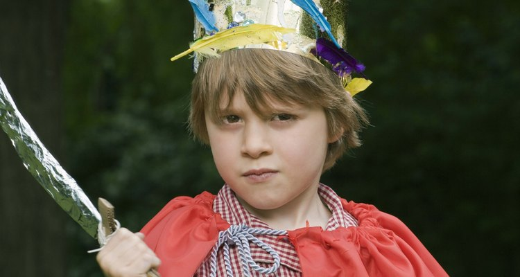 Boy in costume with toy sword