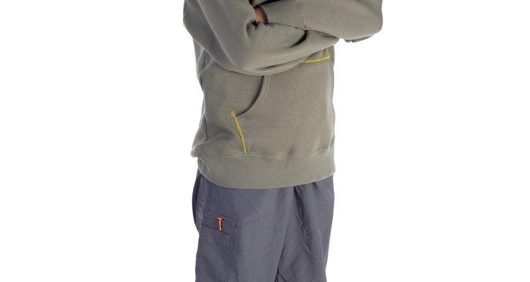 Boy wearing shorts and hooded sweatshirt