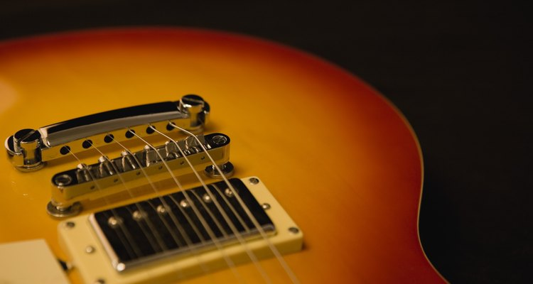 Grounding a guitar's electronics to the bridge provides a good way to mitigate electrical interference and ground loops.