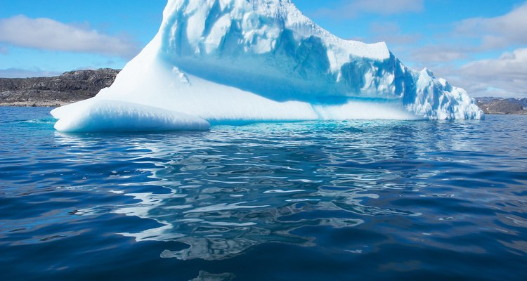 Icbergs are large chunks of ice in a body of water.