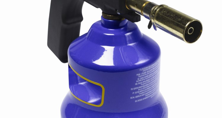A regular propane blowtorch burns hot enough to melt down scrap aluminium.