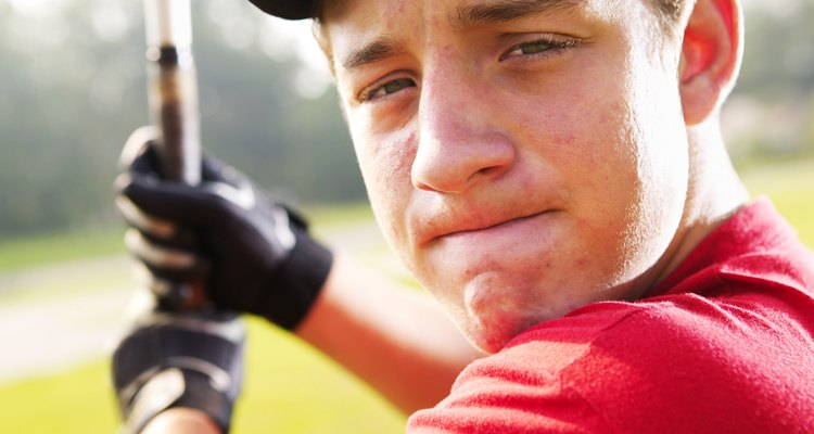 Close-up of a baseball player's face as he concentrates preparing to hit the ball