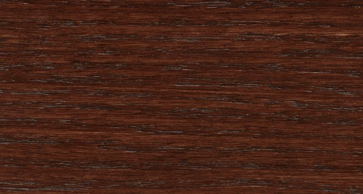 Deep-toned mahogany wood will bleed through paint if you don't prime.