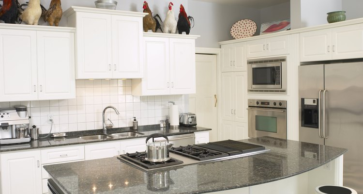 Grease and grime can build up quickly on kitchen cabinets