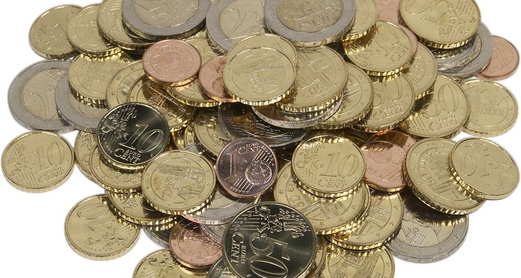 Use old coins such as pennies or tokens to create a keychain.
