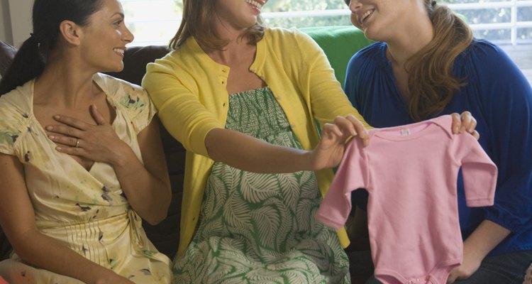 Smiling women at baby showerJupiterimages
