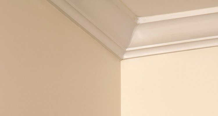Crown moulding is much easier to install when you have a plastic moulding kit.