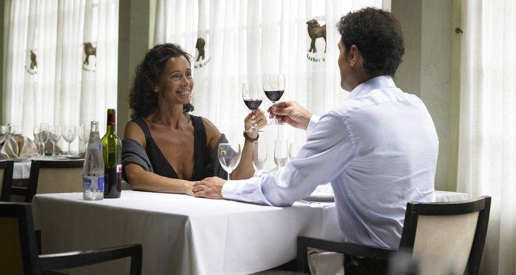 Couple toasting wine in restaurant