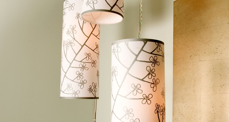 Round paper lampshades with ribbon trim at the top and bottom edges.