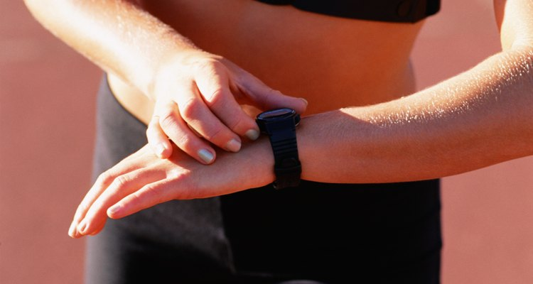 Woman looking at wristwatch in sports attire
