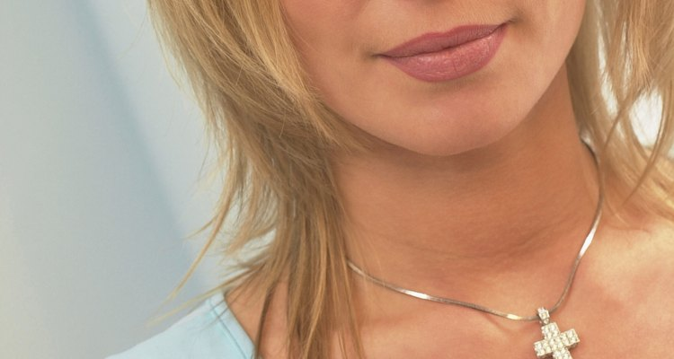Portrait of a mid adult woman wearing a crucifix pendant
