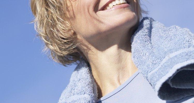 Sweaty woman smiling outdoors