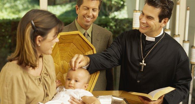 priest baptizing a baby boy