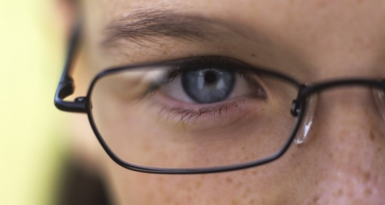 Girl (11-13) wearing glasses, close up, portrait