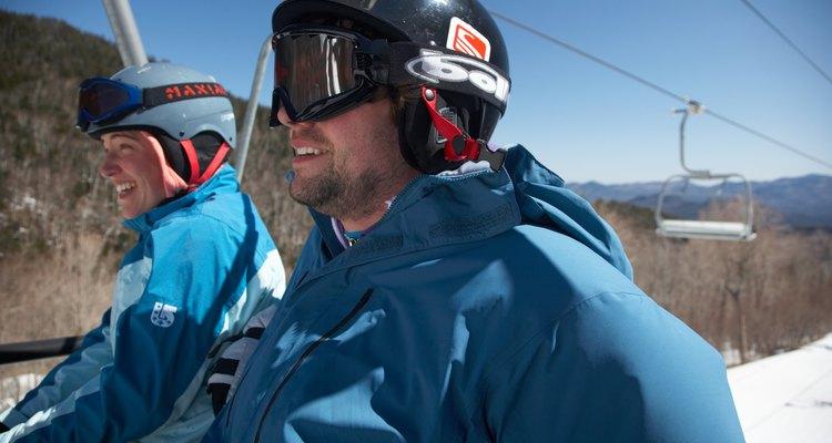 Young couple rioding ski lift