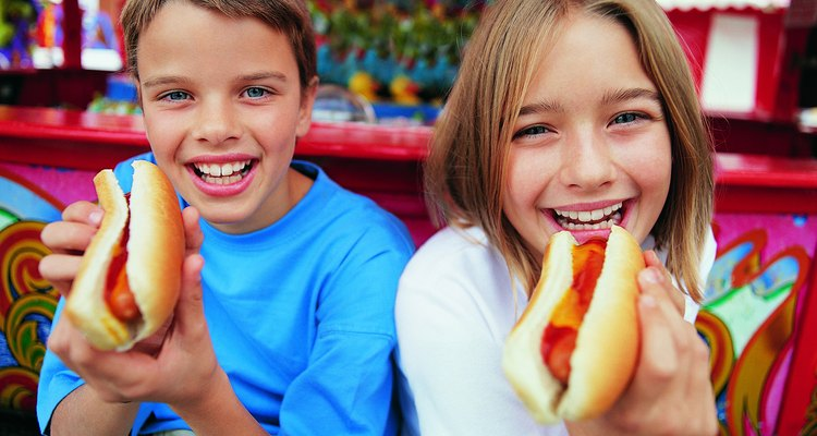 Portrait of a Brother and Sister Holding Hot Dogs