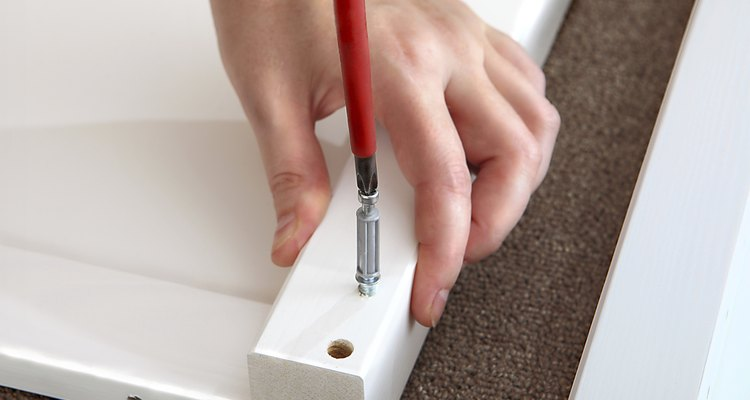 Unscrew the cam lock pin to get it out.