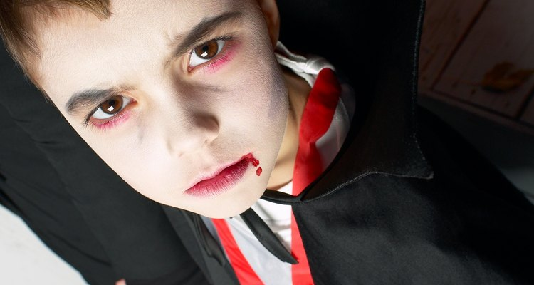 Homemade fangs add authenticity to a vampire costume.